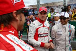 (Da sinistra a destra): Fernando Alonso, Ferrari con Jules Bianchi, Marussia F1 Team e Felipe Massa,