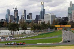 Lewis Hamilton, Mercedes AMG F1 W05 and Daniel Ricciardo, Red Bull Racing RB10 battle for position