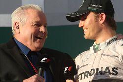 (L to R): Alan Jones, interviews race winner Nico Rosberg, Mercedes AMG F1 on the podium