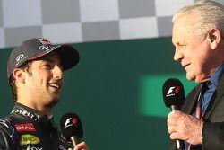 (L to R): Daniel Ricciardo, Red Bull Racing is interviewed by Alan Jones, on the podium