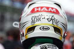Lewis Hamilton, Mercedes AMG F1 with a message on the rear of his helmet, on the grid