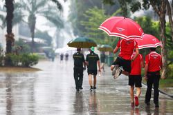 Jules Bianchi, Marussia F1 Team in a wet and rainy paddock