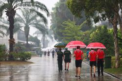 (L to R): Jules Bianchi, Marussia F1 Team and Max Chilton, Marussia F1 Team in a wet and rainy paddo