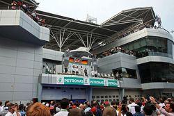 The podium, Mercedes AMG F1, second; Lewis Hamilton, Mercedes AMG F1, race winner; Sebastian Vettel,