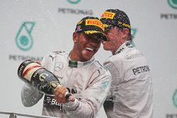 Race winner Lewis Hamilton, Mercedes AMG F1 celebrates on the podium with second placed team mate Ni