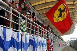 Ferrari fan and flag in the grandstand