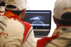 Mads Ostberg and Jonas Andersson watch recce video