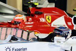 瓦塔里·博塔斯, 威廉姆斯FW36赛车,和基米·莱库宁, 法拉利F14-T赛车,在检录处