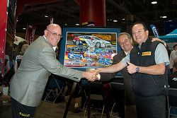 Scott Bove, Hector Cademartori and Rafael Navarro unveil the 25th anniversary poster of the series