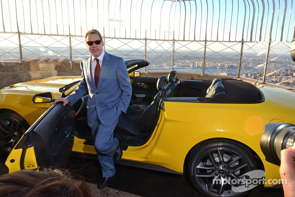 Bill Ford with a Ford Mustang convertible built on the 86th floor of the Empire State Building to celebrate the brand's 50th anniversary