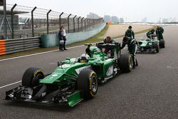 Marcus Ericsson, Caterham CT05 and team mate Kamui Kobayashi, Caterham CT05 on the grid.