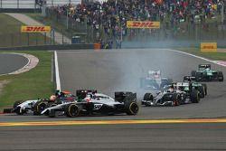 Jenson Button, McLaren MP4-29; Sergio Perez, Sahara Force India F1 VJM07