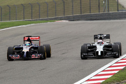 Jenson Button, McLaren MP4-29 and Jean-Eric Vergne, Scuderia Toro Rosso STR9 battle for position