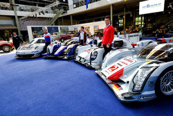 A Porsche 911 RSR, Toyota TS040 Hybrid, Porsche 919 Hybrid and Audi R18 e-tron quattro on display at the Autoworld museum in Brussels