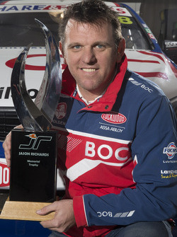 Jason Bright with the Jason Richards Memorial Trophy