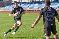 Jamie Whincup traint met Aussie Rules Football-team the Warriors