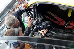 Norbert Haug, a former German football player after he drove a Audi DTM taxi
