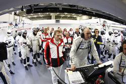 The Porsche team looks on