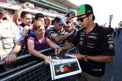 Sergio Perez, Sahara Force India F1 signs autographs for the fans in the pits
