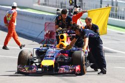The Red Bull Racing RB10 of Sebastian Vettel, Red Bull Racing is recovered back to the pits after he