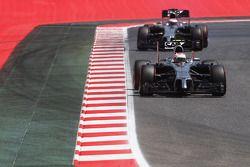 Kevin Magnussen, McLaren MP4-29 leads team mate Jenson Button, McLaren MP4-29