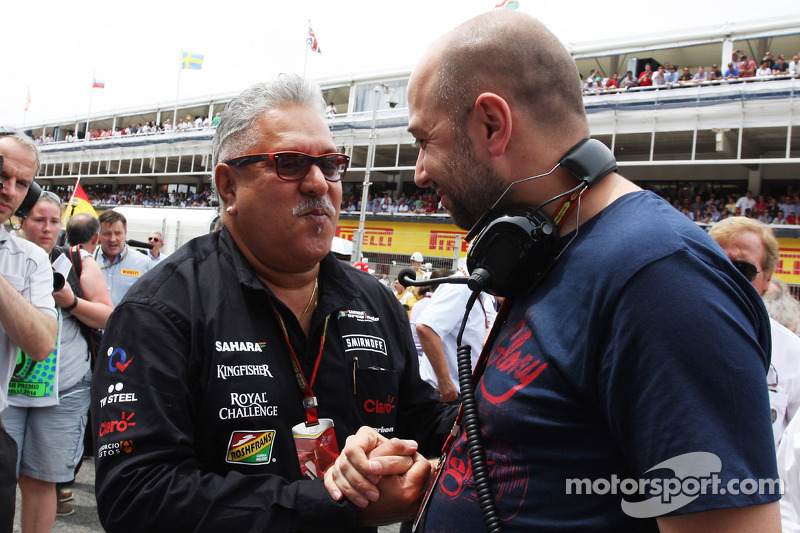 (L to R): Dr. Vijay Mallya, Sahara Force India F1 Team Owner with Gerard Lopez, Lotus F1 Team Principal on the grid