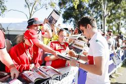Charles Leclerc, Sauber, signs an autograph