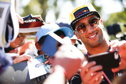 Daniel Ricciardo, Red Bull Racing, takes a photo of himself with a fan