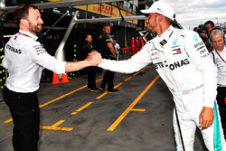 Pole sitter Lewis Hamilton, Mercedes-AMG F1 celebrates in parc ferme with team members