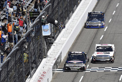 John Hunter Nemechek, NEMCO Motorsports, Chevrolet Silverado races Kyle Benjamin, DGR-Crosley, Toyota Tundra Crosley Brands/Tropicana to the finish line to win at Martinsville