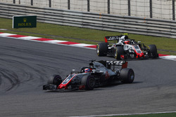 Romain Grosjean, Haas F1 Team VF-18 Ferrari, leads Kevin Magnussen, Haas F1 Team VF-18 Ferrari
