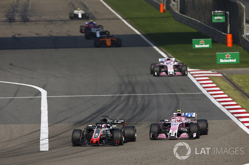 Romain Grosjean, Haas F1 Team VF-18 Ferrari, Esteban Ocon, Force India VJM11 Mercedes, and Sergio Perez, Force India VJM11 Mercedes