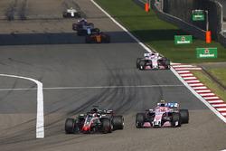 Romain Grosjean, Haas F1 Team VF-18 Ferrari, Esteban Ocon, Force India VJM11 Mercedes, and Sergio Perez, Force India VJM11 Mercedes