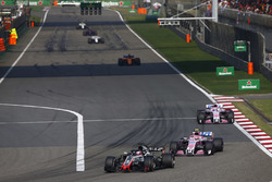 Romain Grosjean, Haas F1 Team VF-18 Ferrari,leads Esteban Ocon, Force India VJM11 Mercedes, and Sergio Perez, Force India VJM11 Mercedes
