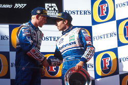 Race winner Jacques Villeneuve, (left) shakes hands with his Williams team mate Heinz-Harald Frentzen, who finished third
