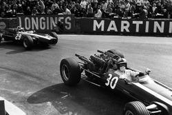 Pedro Rodriguez, Cooper T81-Maserati, leads Jochen Rindt, Cooper T81B-Maserati