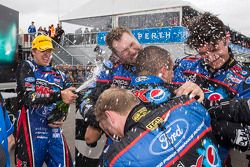 Race winner Chaz Mostert celebrates with Mark Winterbottom