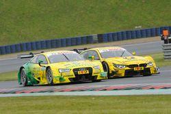 Mike Rockenfeller en el Audi RS 5 DTM del equipo Audi Sport Phoenix, contra Timo Glock, del equipo B