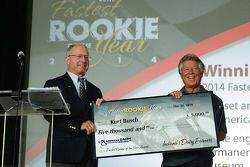 Mario Andretti accepts Kurt Busch's $5,000 check for being the 2014 Indianapolis 500's fastest rookie Anne Proffit photo
