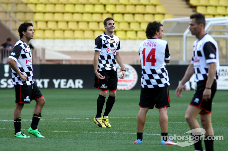 (L to R): Sergio Perez, Sahara Force India F1; Jules Bianchi, Marussia F1 Team; and Fernando Alonso, Ferrari at the charity football match