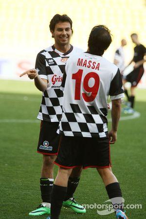 (L to R): Sergio Perez, Sahara Force India F1 and Felipe Massa, Williams at the charity football mat