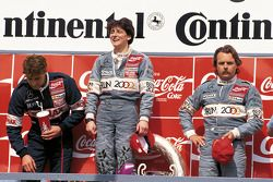 Ellen Lohr and Keke Rosberg on podium at Hockenheim