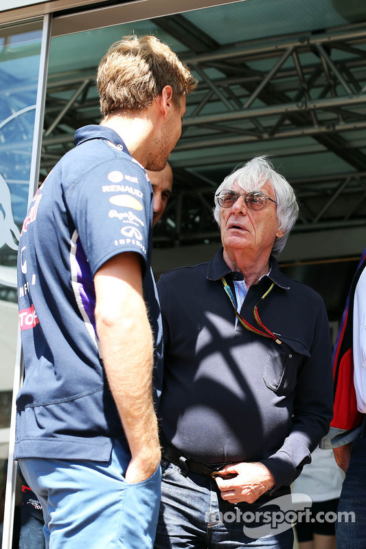 (L to R): Sebastian Vettel, Red Bull Racing with Bernie Ecclestone