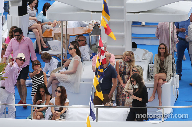 Fans on boats in the scenic Monaco Harbour