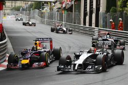 (L to R): Sebastian Vettel, Red Bull Racing RB10 and Kevin Magnussen, McLaren MP4-29 battle for posi