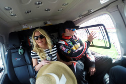 Kurt Busch waves from a helicopter prior to landing at Charlotte Motor Speedway