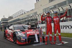 Race winners Tsugio Matsuda and Ronnie Quintarelli celebrate