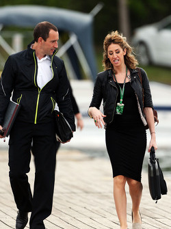 F1 personnel enter the track