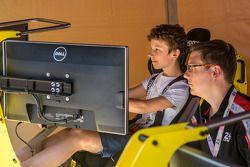 Fans enjoying the racing simulator at scrutineering