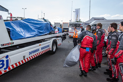The crashed #1 Audi Sport Team Joest Audi R18 E-Tron Quattro back to the Audi compound after Loic Duval massive accident